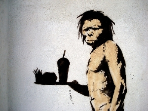 Banksy caveman with chips and burgers on a tray - video content marketing examples